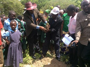 Reforestation is an important climate change mitigation strategy. Chief Chamuka and a senior headman planting the first tree of the reforestation activity at the project inauguration in Kanakantapa.